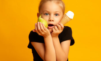 excitement-little-dancer-with-apple-ice-cream-during-break